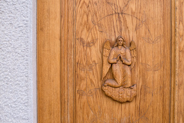 Angel carved on a wooden door