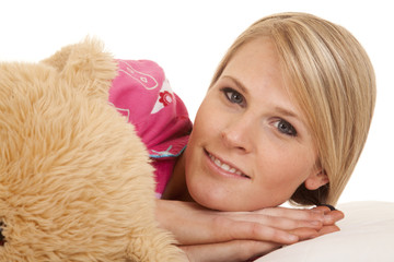 woman pink pajamas bear lay look