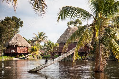 Fotobehang Centraal-Amerika Landen Houses over pillars at a Black lake in the cuban tourist village