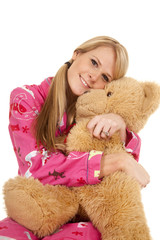 woman pink pajamas bear sit hug