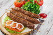 canvas print picture - shish kebabs on wooden skewers