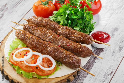 canvas print picture shish kebabs on wooden skewers