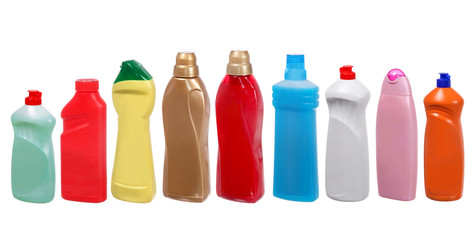 colorful plastic bottles of cleaning products on white