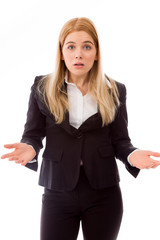 Shocked businesswoman shrugging with raised hands