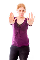 Young woman making stop gesture sign from both hands
