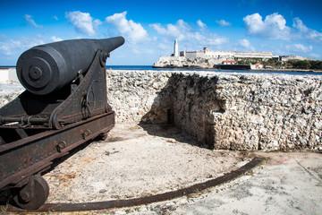 Cannon looking at castle los Tres Santos Reyes Magnos del Morro