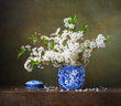 Still life with bouquet of cherry blossoms in a chinese vase