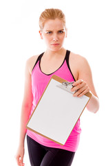 Young woman holding a clipboard and staring toward camera