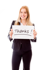 "Businesswoman holding a message board with the text words ""thank"