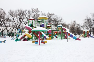 Playground covered by snow