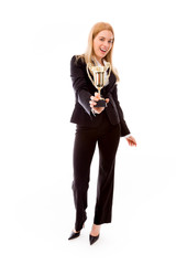 Businesswoman holding a golden trophy