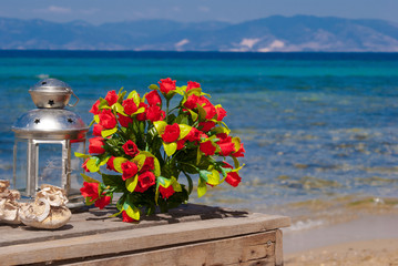 Wedding bouquet of roses on the beach