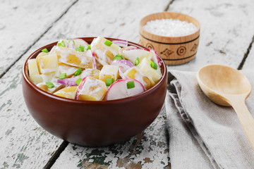 Potato salad with radishes and onions