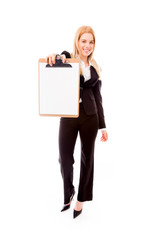 Businesswoman showing a blank clipboard