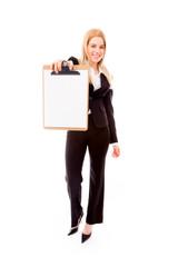 Businesswoman showing a blank clipboard