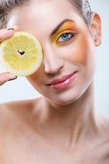Beautiful woman with lemon and yellow makeup