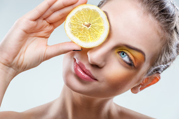 Beautiful woman with lemon and yellow makeup