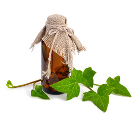 Hedera with a pharmaceutical bottle