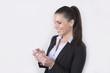 Beautiful business woman using her smartphone (telephone)