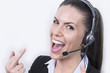 Beautiful business woman showing fuck - you (headset, portrait)