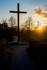Christian cross in the sunset