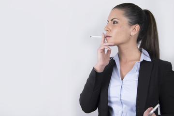 beautiful business woman smoking a cigarette