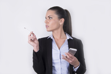 beautiful business woman smoking a cigarette (smartphone)