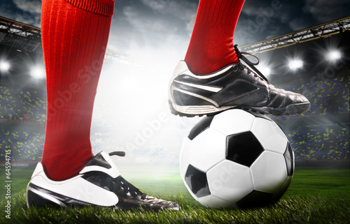 canvas print picture legs of a soccer player