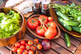 Tomatoes, salad and cucumbers-vegetables for picnic. Outdoors