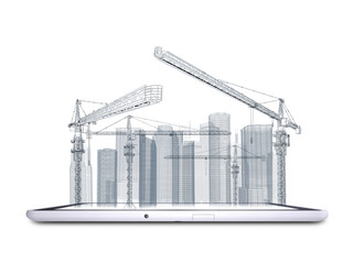 Tower crane and skyscrapers on the tablet pc