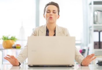 Business woman with laptop relaxing