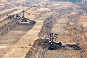 Very large excavators digging lignite in a mine