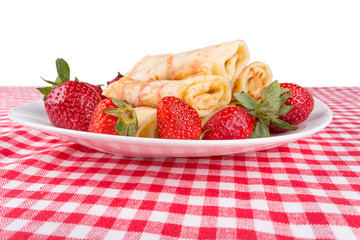 pancakes with cherry jam and strawberries
