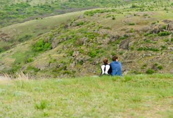 Romantic couple sitting enjoying the outdoors