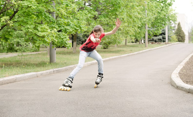Beautiful young teenage girl roller skating