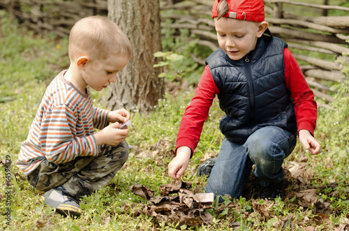 Two young boys playing with matches