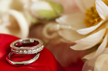 wedding rings on colorful fabric