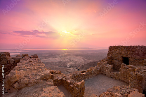 Leinwanddruck Bild Beautiful sunrise over ancient Masada fortress in Israel