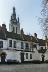 Kortrijk Beguinage and the tower of St. Martin's (Maarten) churc