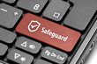 Safeguard. Red hot key on computer keyboard.