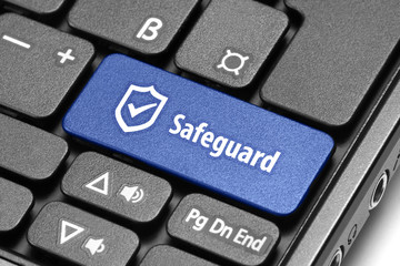 Safeguard. Blue hot key on computer keyboard.