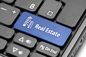 Real Estate. Blue hot key on computer keyboard.