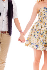 Lesbian couple standing together and holding hands