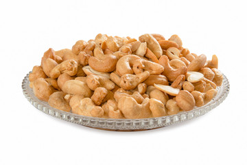 cashew nuts in a crystal dish isolated