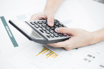 woman hand with pen and business report.Accounting