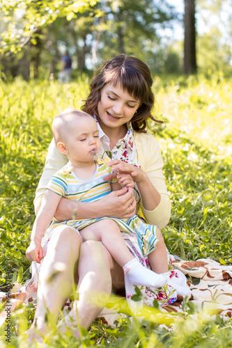 mom and kid outdoors at summer