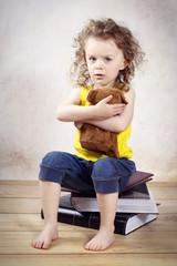 Little anxious girl with teddie bear