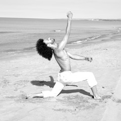 Portrait of handsome male dancer on the beach