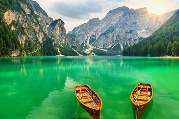 Wonderful mountain lake and boats in the Dolomites,Italy