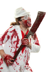 Mad butcher covered in blood with a teddy bear on an axe